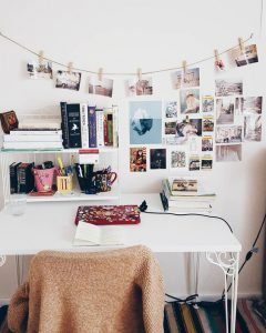 home office with photos strung up